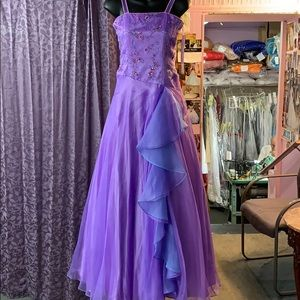 A purple prom or sweet 16 gown.